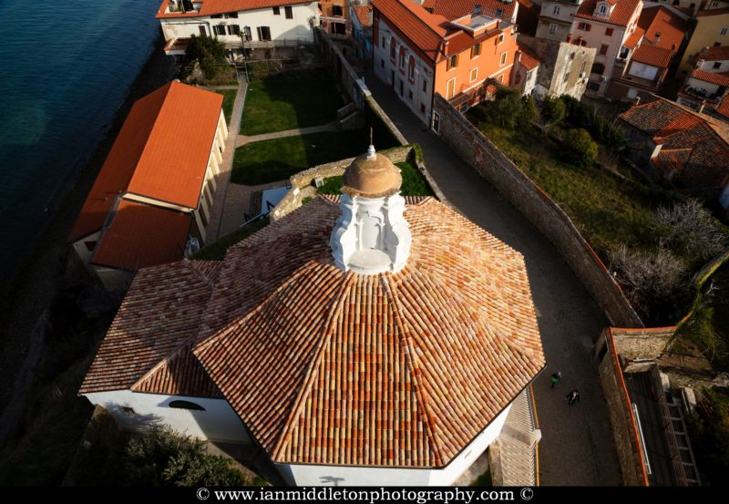 View of the Saint John's Baptistry from Saint George's campanile in Piran, Slovenia. The campanile was built as a smaller replica of the one in Piazza San Marco in Venice.