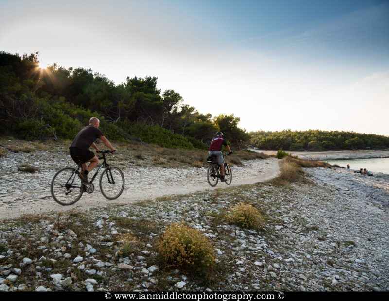 Cycling past Drazice Cove on the Kamenjak Peninsula, at the very tip of Istria in Croatia.