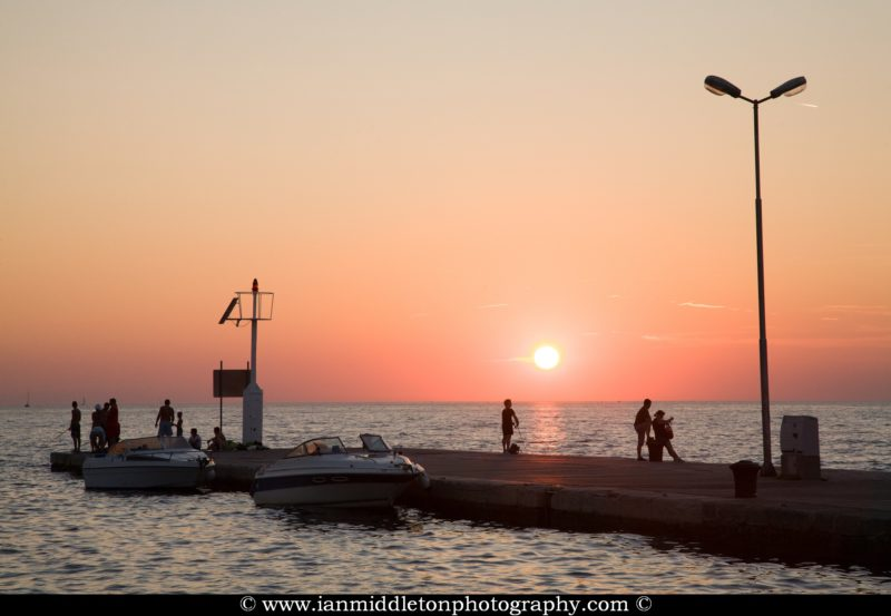 Sun setting over Izola harbour, Slovenia