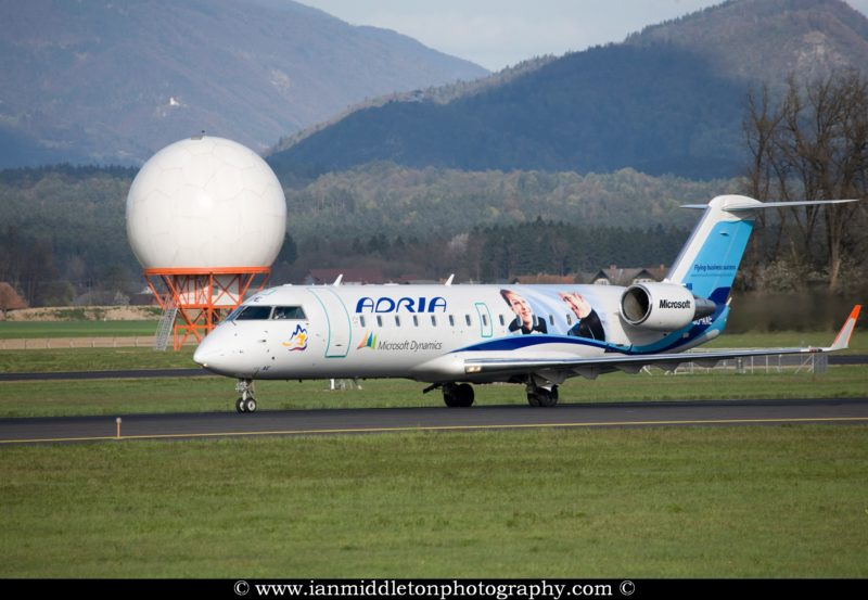 Adria aircraft with Microsoft advertising on the side at Ljubljanas Joze Pucnik Airport in Brnik, Slovenia.