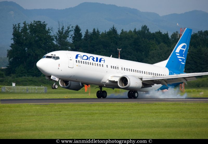 Adria Aircraft landing at Ljubljana Joze Pucnik Airport, Brnik, Slovenia.