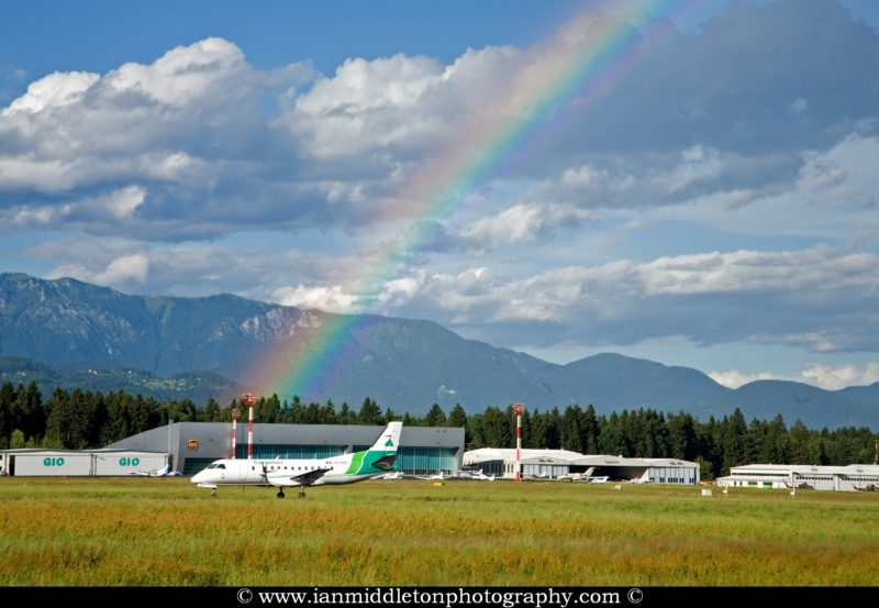 Rainbow in background as Carpatair lands.