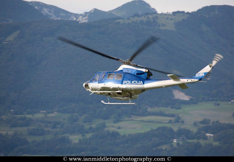 Police helicopter patrolling Ljubljana Joze Pucnik Airport, Slov