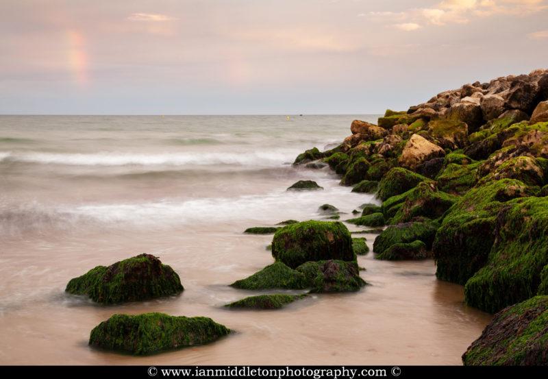 The beautiful coastal landscape at Highcliffe Beach in Dorset.