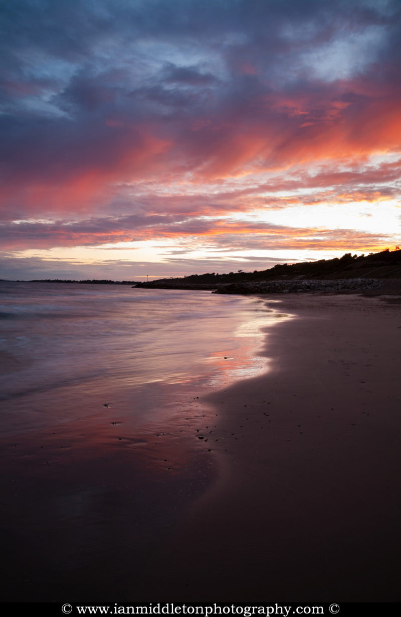 Sunset at Highcliffe Beach in Dorset.