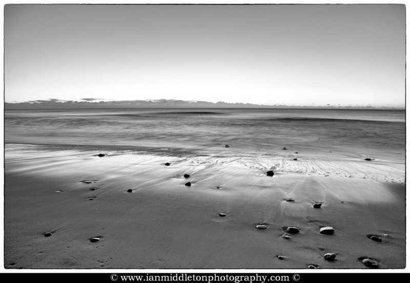 Ballynaclash beach at dawn. Framed fine art black and white.