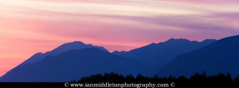 Panoramic view of the Kamnik Alps mountains at Sunset of Slovenia. This image is a 2 frame panoramic taken from a field in Brnik near Ljubljana Airport.