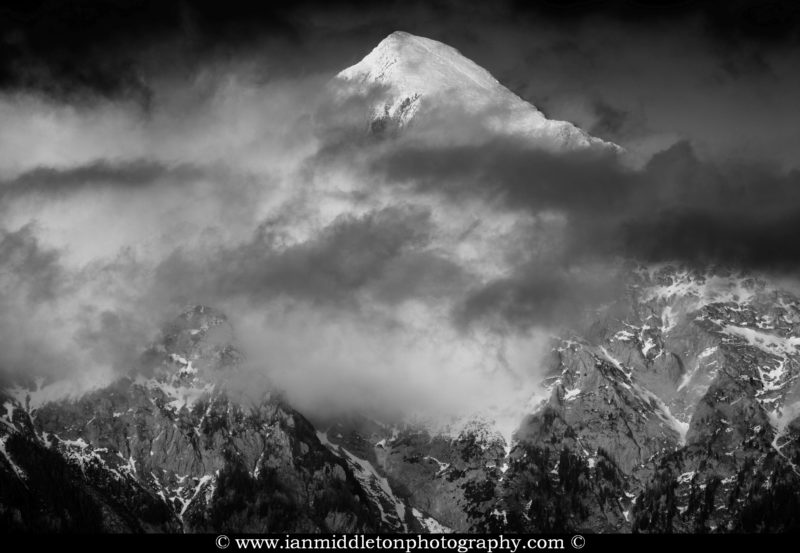 Clouds drifting over the Kamnik Alps, Slovenia. Black and white version.