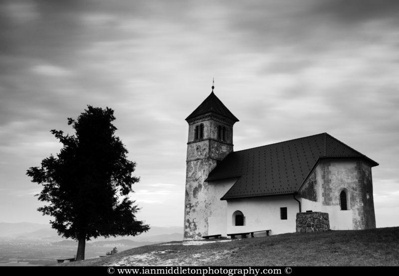 The church of Saint Anna (Sveta Ana). Sveta Ana is perched upon an exposed hill overlooking the Ljubljansko Barje (Ljubljana marsh) near the village of Preserje.