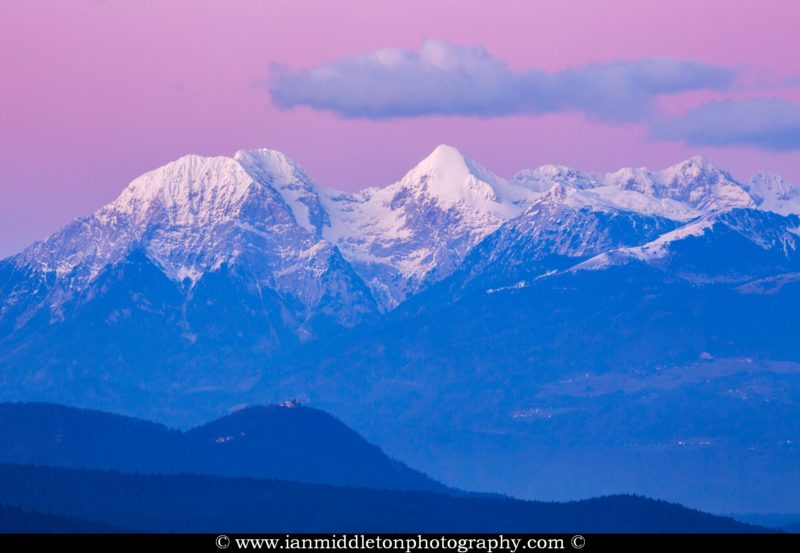 Smarna Gora with the Kamnik Alps behind at sunset, Slovenia. Here you can Mt Grintovec, the highest peak in the kamnik Alps range.