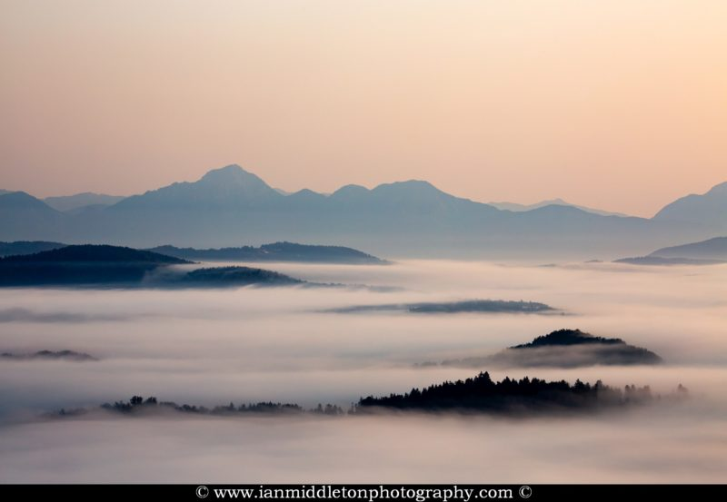 View across the Ljubljana Moors at sunrise to the the Kamnik Alps. Ljubljana Marshland (Ljubljansko Barje), a large area of wetland 160 square kilometres in size.