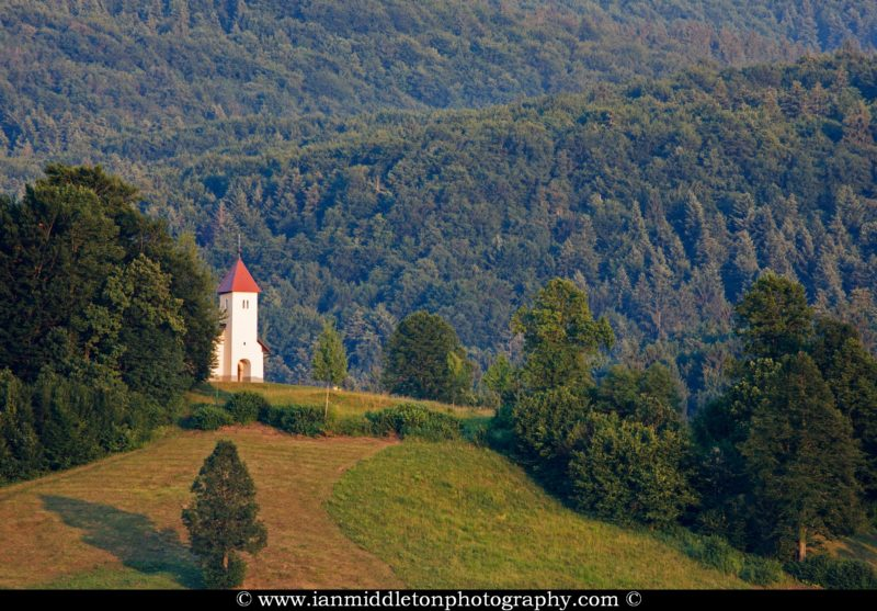 The church of sv. Lovrenc (Saint Lawrence) near Jezero on the Ljubljana Marshland (Ljubljansko Barje), a large area of wetland 160 square kilometres in size. Taken just as the evening sun was falling upon the hill.