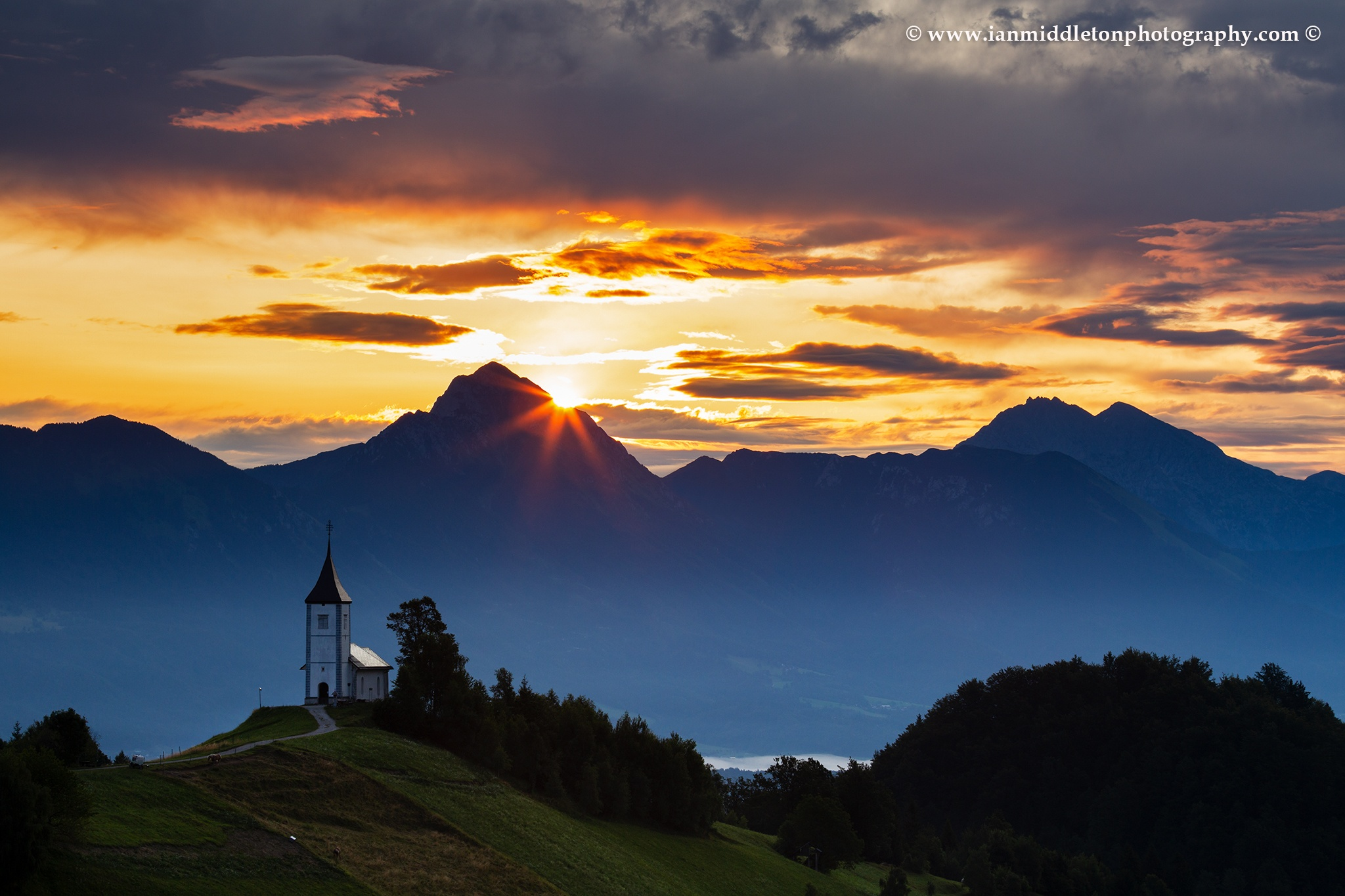 Sunrise over Storzic at Jamnik church, Slovenia.