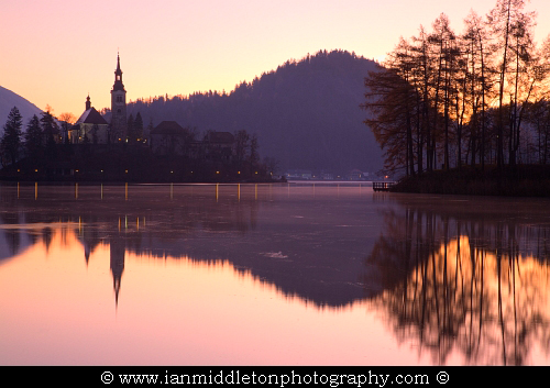 The sun comes up over Lake Bled, Slovenia.