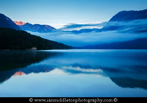 Morning mist and cloud over the Julian Alps at Lake Bohinj, Triglav National Park, Slovenia