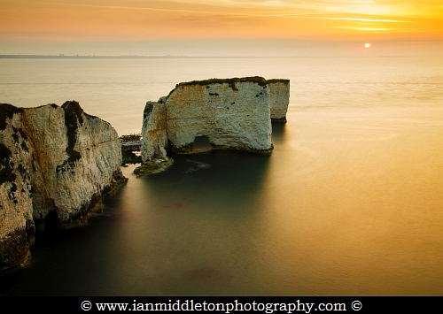 Sunrise at Old Harry Rocks, at Handfast Point on the Isle of Purbeck, Jurassic Coast, Dorset, England. A UNESCO World Heritage Site