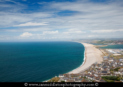 View across Portland, Chesil Beach and Weymouth harbour, Jurassic Coast, Dorset, England.