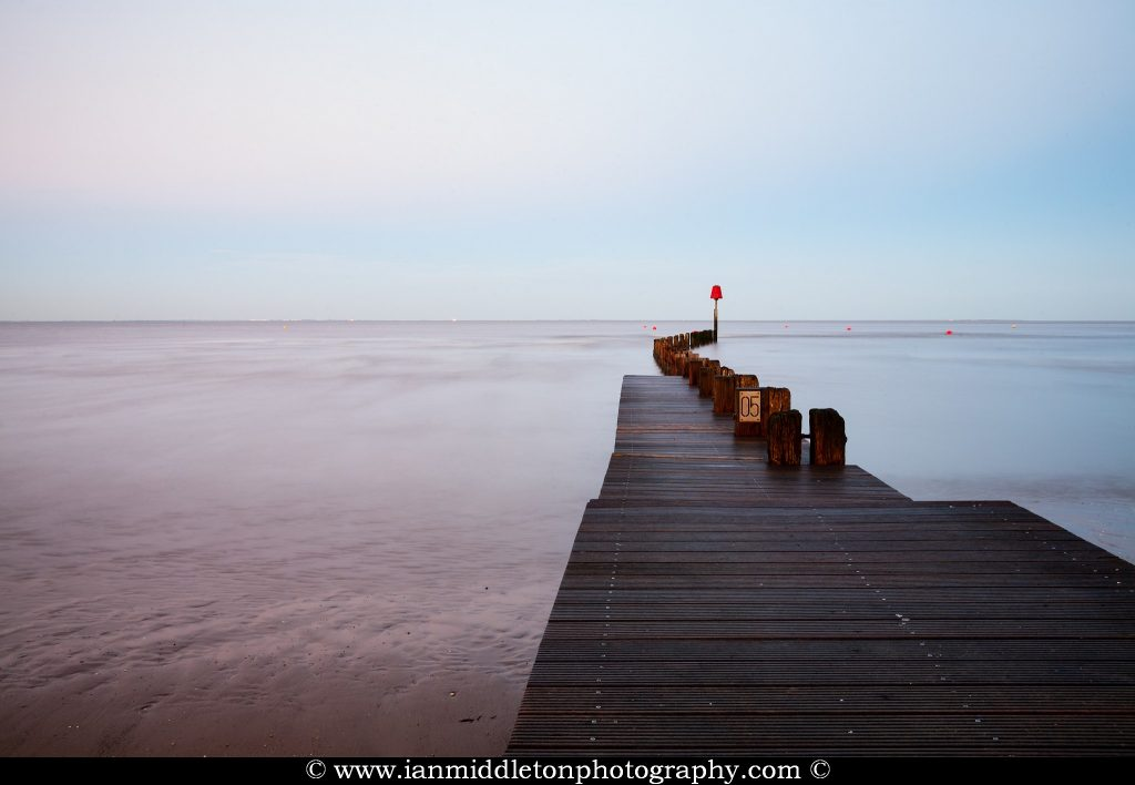 Jetty, Wooden boardwalk and groynes at Cleethorpes Beach, North East Lincolnshire, England