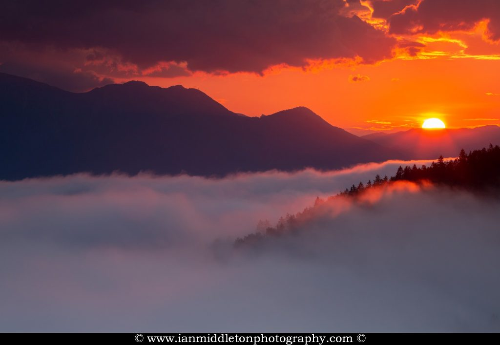 Sunrise over the Kamnik Alps, seen from Rantovše hill near Skofja Loka, Slovenia.
