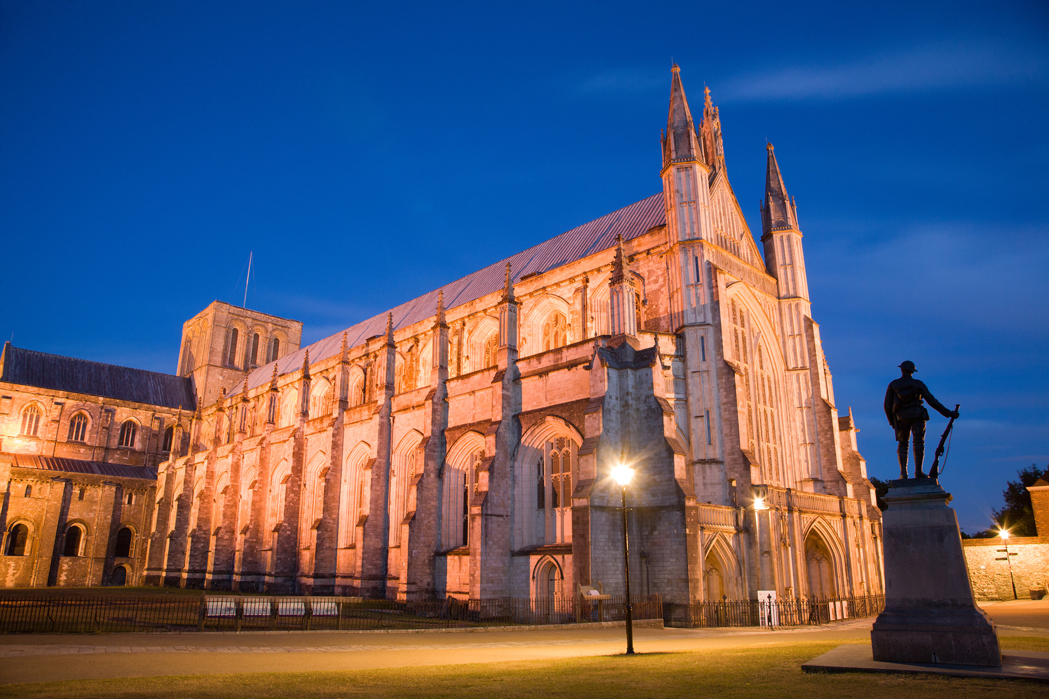 Winchester Cathedral at dusk, Hampshire, England. Winchester is the ancient capital of England.