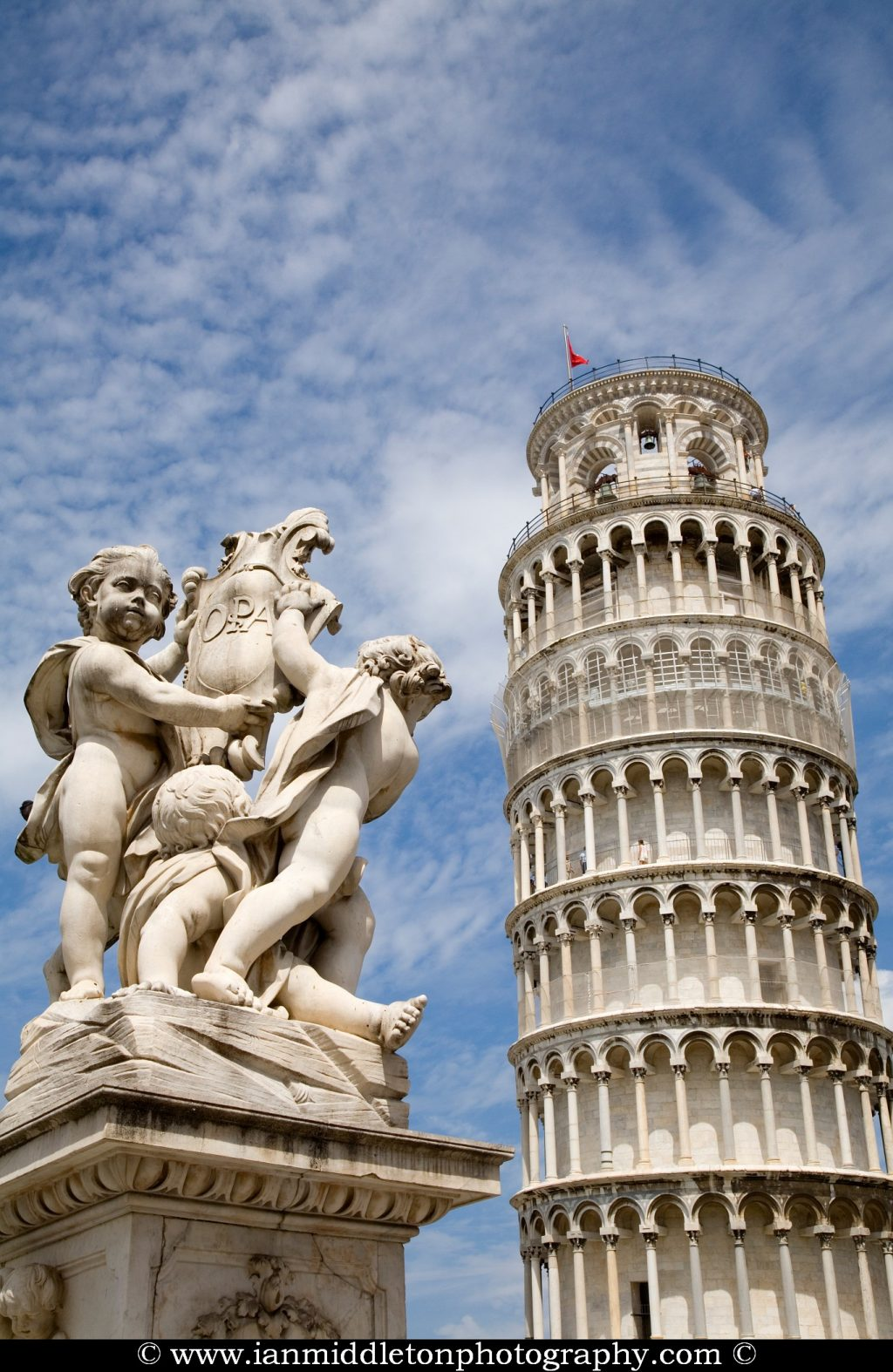 The Cherubs in front of the Leaning tower in Campo di Miracoli (field of Miracles), Pisa, Tuscany, Italy