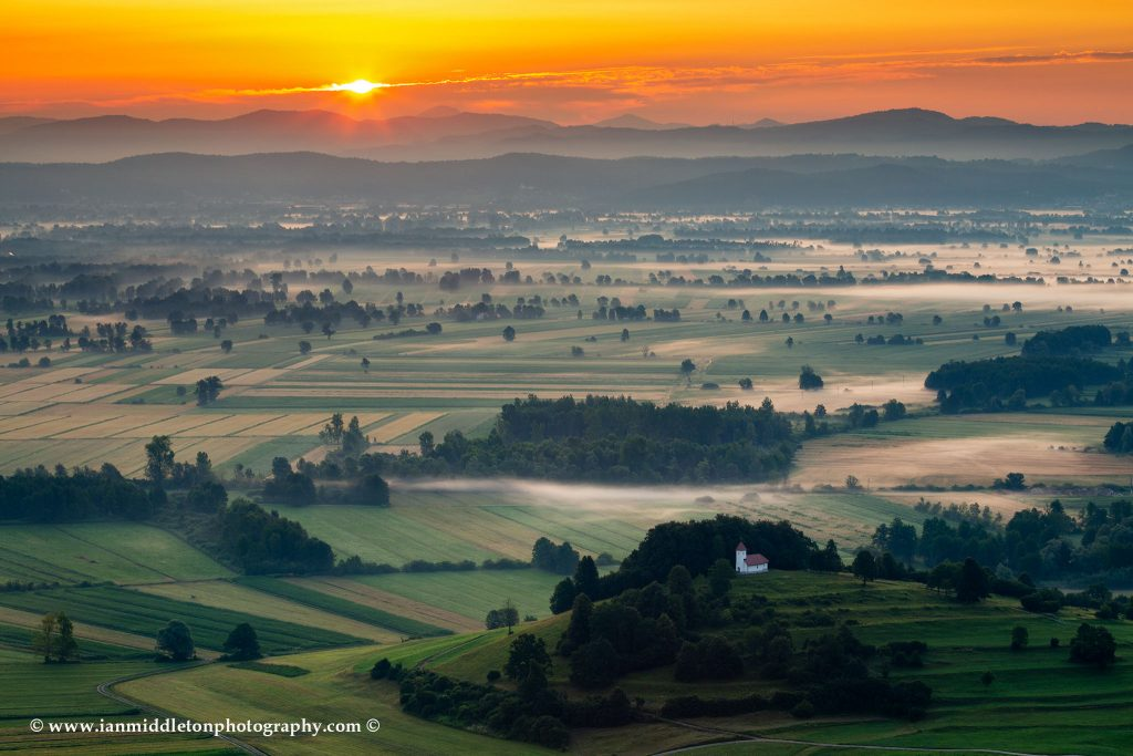 The church of sv. Lovrenc (Saint Lawrence) near Jezero on the Ljubljana Moors at sunrise (Ljubljansko Barje), a large area of wetland 160 square kilometres in size.