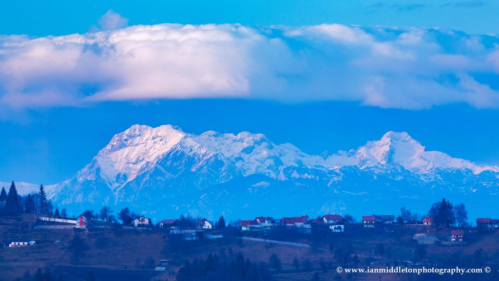 View across to the Kamnik Alps, seen from a hill in prezganje in the Jance hills to the east of Ljubljana, Slovenia