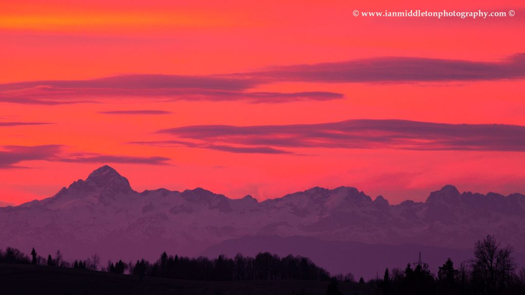 View across to the Mount Triglav and the Julian Alps mountains in the west at sunset.