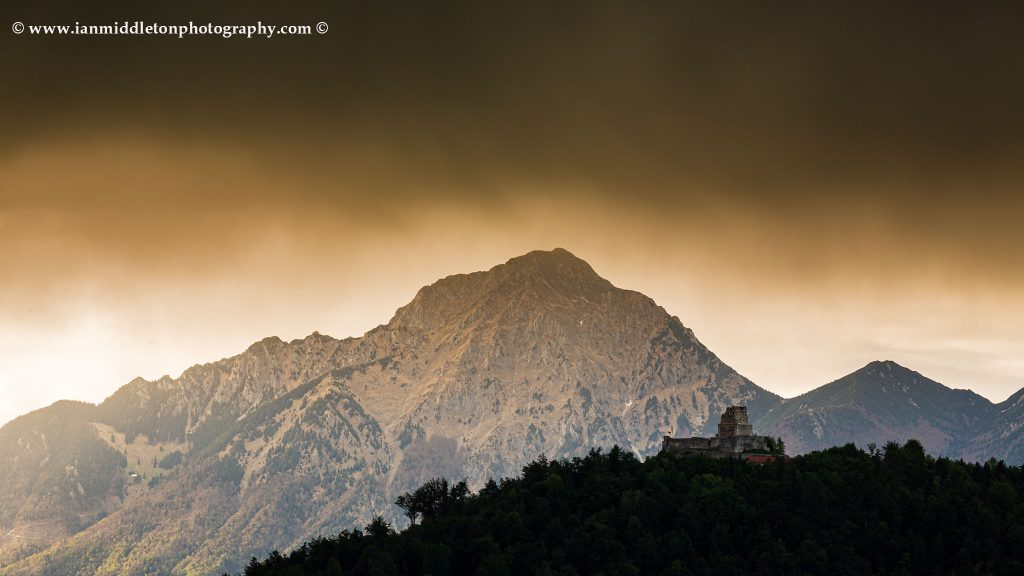 View of the ruins of Smlednik Castle with Storzic mountain as a storm passed over, Slovenia.
