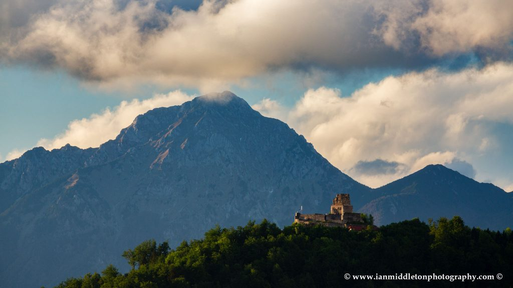 View of the ruins of Smlednik Castle with Storzic mountain, part of the Kamnik Alps, behind, Slovenia.